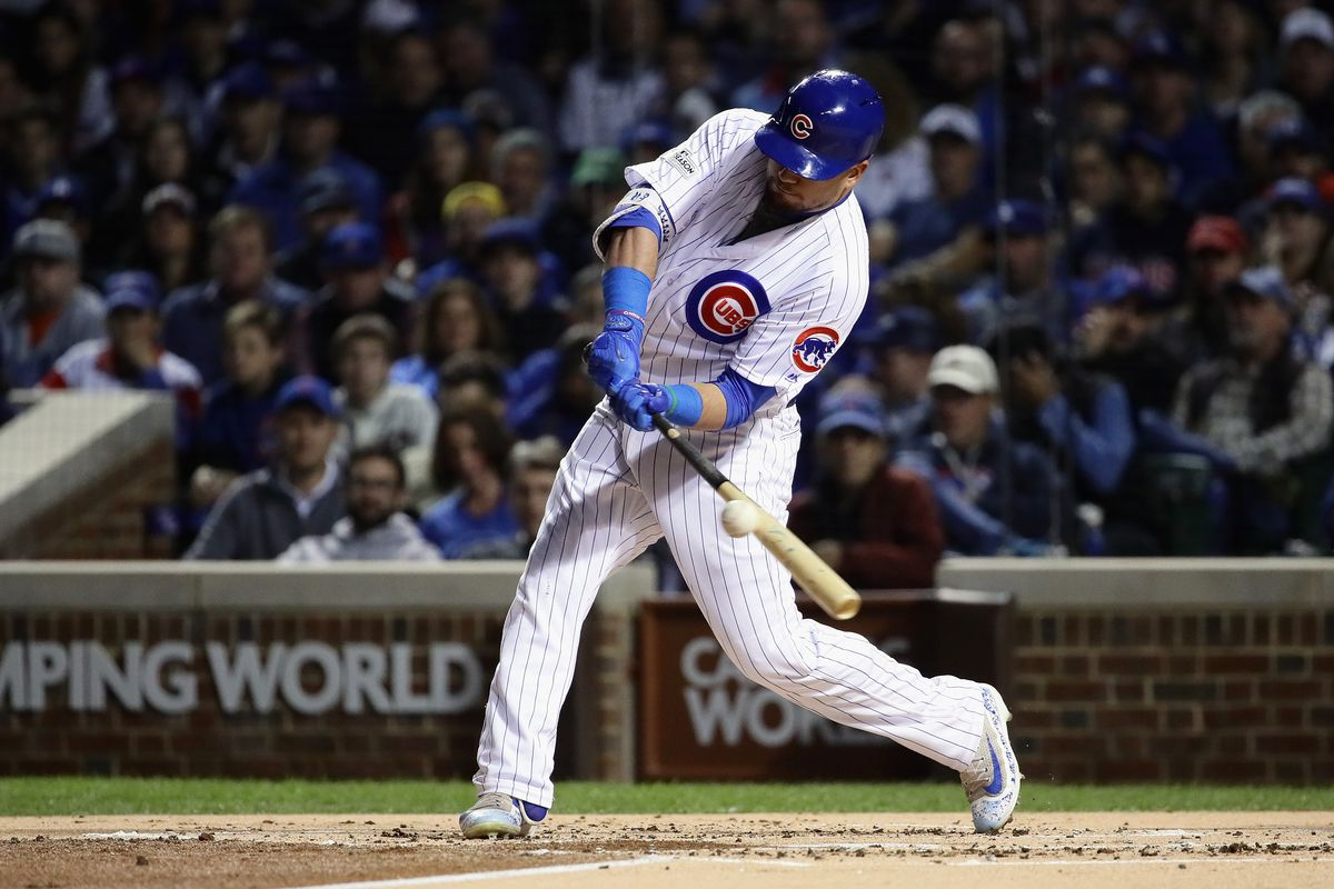 CHICAGO, IL - OCTOBER 18:  Kyle Schwarber #12 of the Chicago Cubs lines out in the first inning against the Los Angeles Dodgers during game four of the National League Championship Series at Wrigley Field on October 18, 2017 in Chicago, Illinois.  (Photo by Jonathan Daniel/Getty Images)