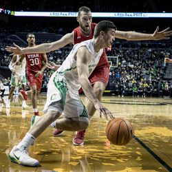 Oregon guard Payton Pritchard (3) drives against Utah forward David Collette (13) during the first half in an NCAA college basketball game Friday, Dec. 29, 2017, in Eugene, Ore. (AP Photo/Thomas Boyd)