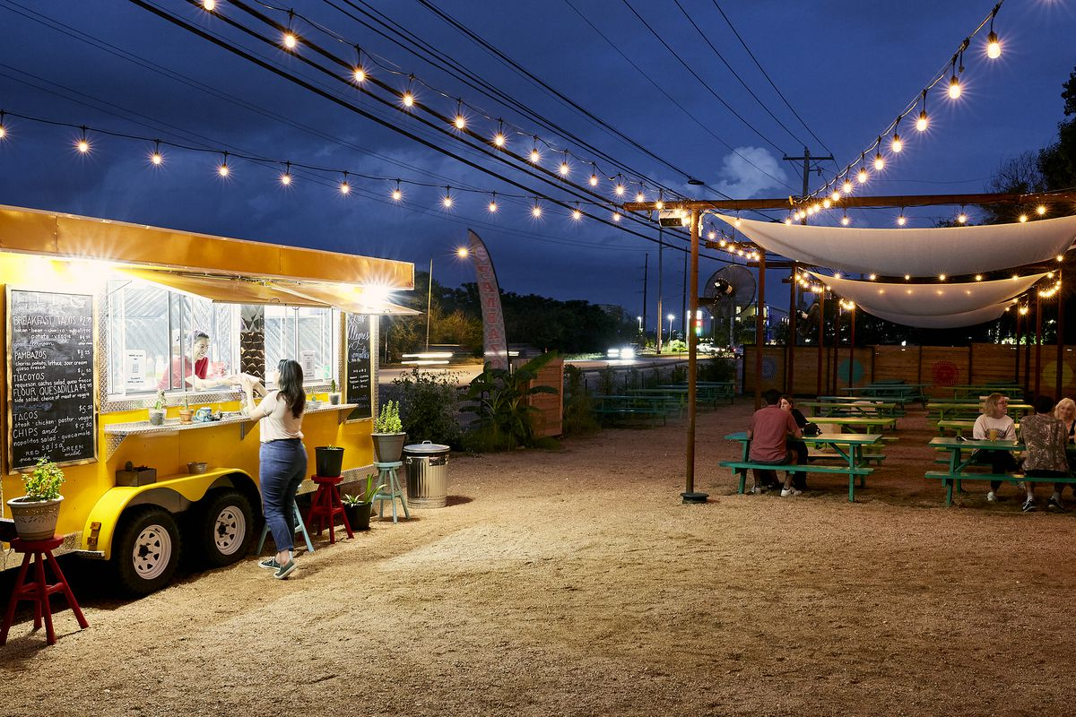 Ani's courtyard and the Las Alegres Comadres truck at night