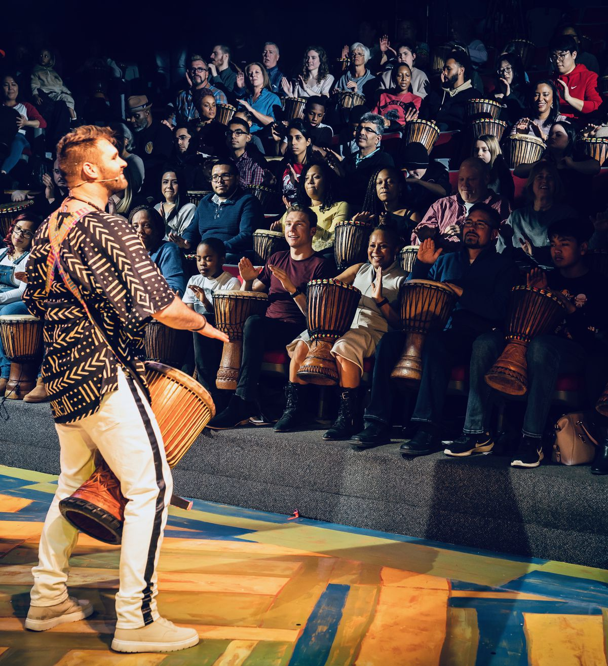 """Ben Hope gets the audience to participate in the drumming fun during """"DJEMBE! The Show."""" 