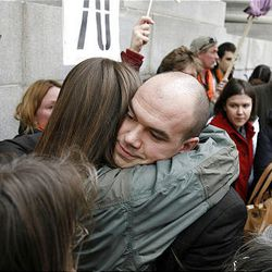 Tim DeChristopher hugs people as he leaves court following a guilty verdict on two federal charges -- interfering with an onshore oil and gas leasing act and making a false representation to the federal government -- in Salt Lake City on Thursday, March 3, 2011.