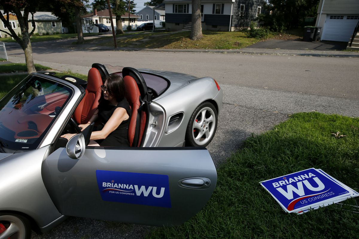 Congressional candidate Brianna Wu pops the trunk of her car so she can load campaign signs in the back