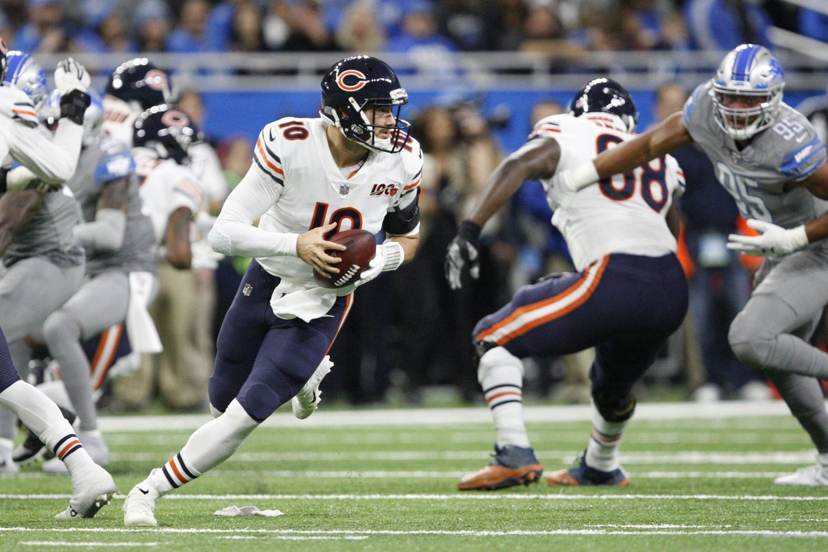 Chicago Bears quarterback Mitchell Trubisky rolls out to pass the ball during the second quarter against the Detroit Lions at Ford Field.