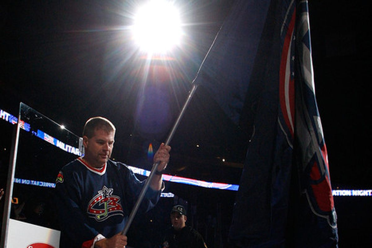 Let's ignore that this guy is carrying a Blue Jackets flag, okay? It's a nice photo.