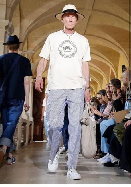 5e4dd8a484affa A model walks in a Noble Fine Liquor t-shirt at Comme des Garçons' Paris  Fashion Week show last week