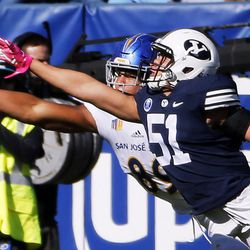 Brigham Young Cougars linebacker Morgan Unga successfully defends a pass to San Jose State Spartans tight end Josh Oliver during NCAA football in Provo on Saturday, Oct. 28, 2017.