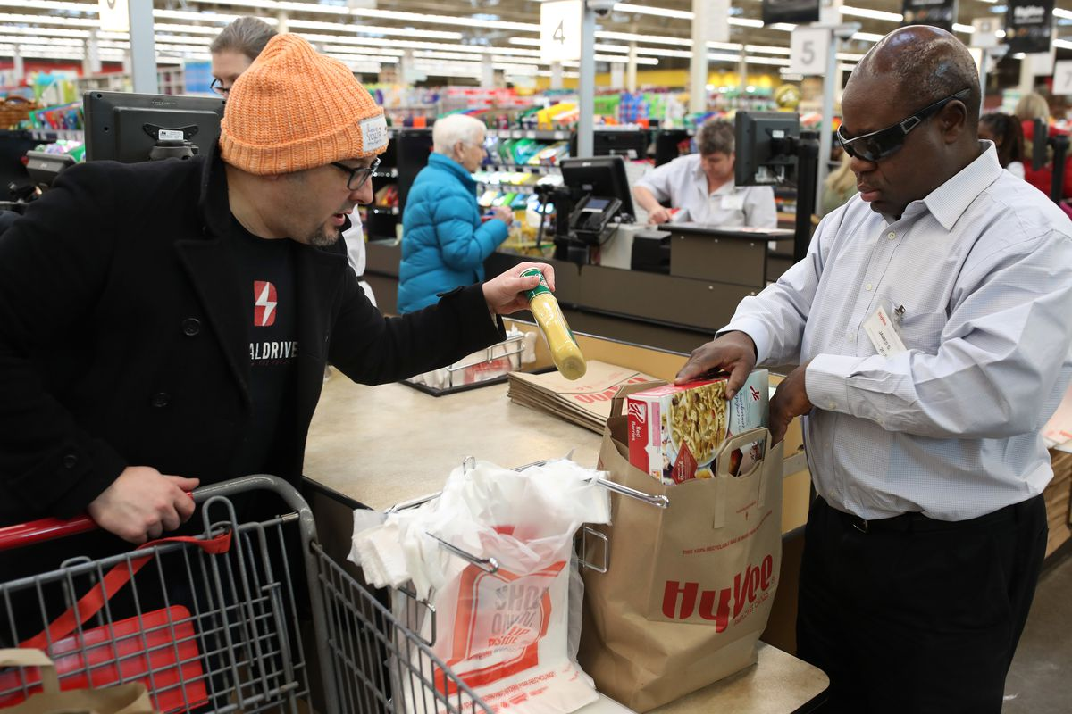 James Sloan an employee at Hy-Vee bagged grocery for a customer Scott Ware Thursday Feb 22 2018 in New Hope, MN.] Sloan is blind and has been an employee at the store since 2015 JERRY HOLT • jerry.holt@startribune.com