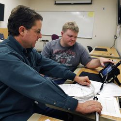 Students Todd Dornberger, front, and Matthew Bringhurst check pipes for flaws at Salt Lake Community College's Westpointe Center in Salt Lake City on Wednesday, Dec. 9, 2015.