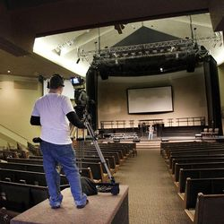 Jessy Graves tests video at the Life Center Church sanctuary in Tacoma, Wash., Friday, Feb. 10, 2012 in preparation for the memorial for Susan Cox Powell, Charlie Powell and Braden Powell.