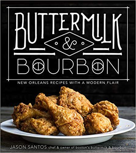 A cookbook cover has a black background, white text, and a plate full of fried chicken.