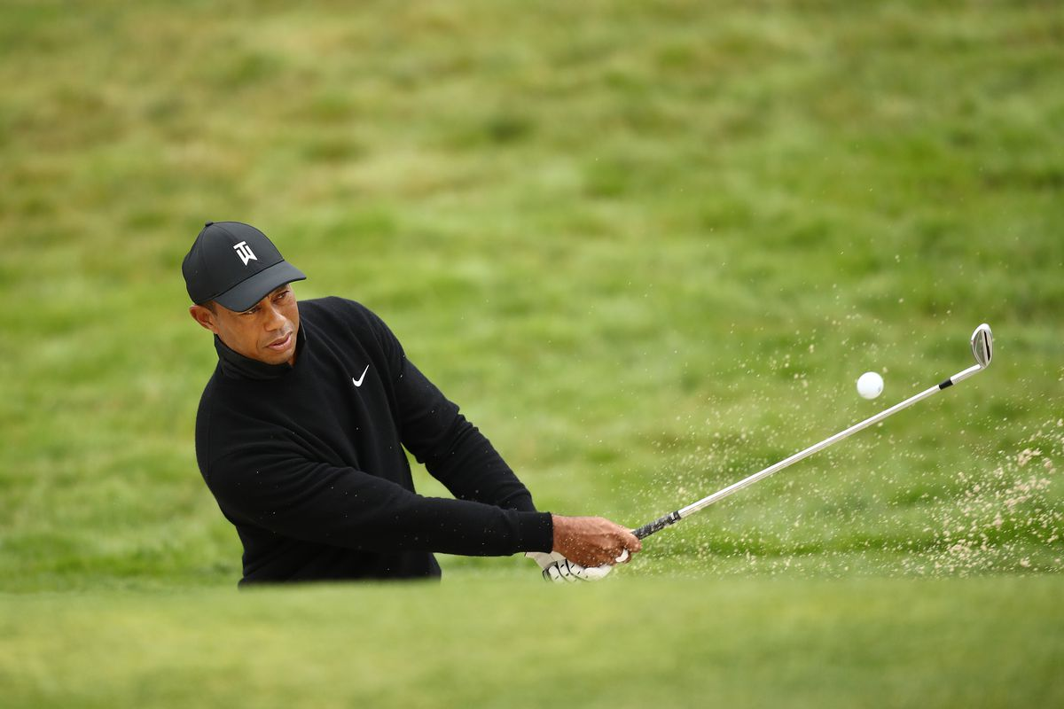 Tiger Woods of the United States plays a shot from a bunker on the 12th hole during a practice round prior to the 2020 PGA Championship at TPC Harding Park on August 05, 2020 in San Francisco, California.