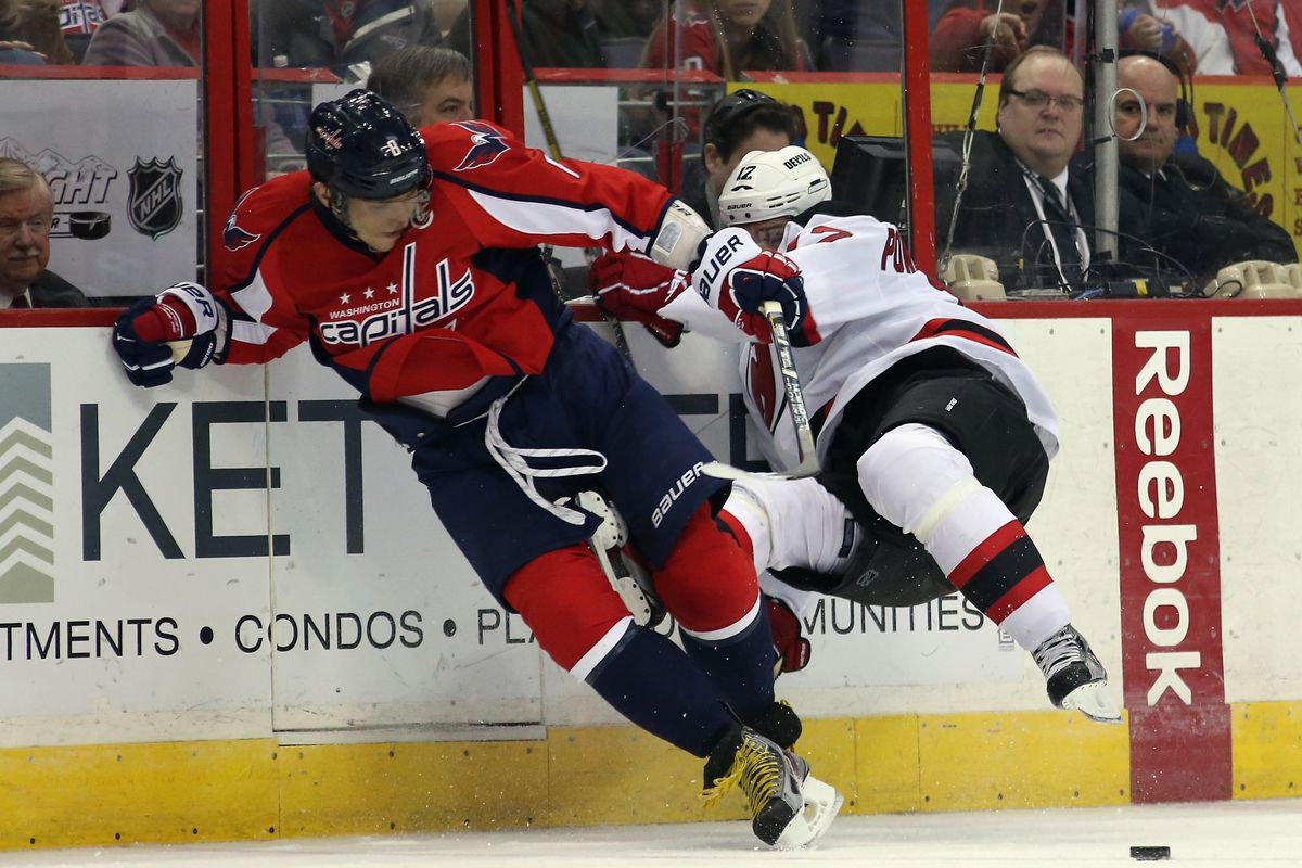 """If it wasn't for Hedberg's Folly, this recap would have been titled """"Ovechkin Scrubs Devils"""" or something. Instead, here's a picture of him hitting Alexei Ponikarovsky."""