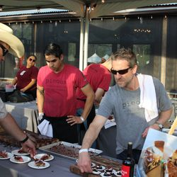 Josh Kaner of Pieous dishes out pastrami sliders and brownies.