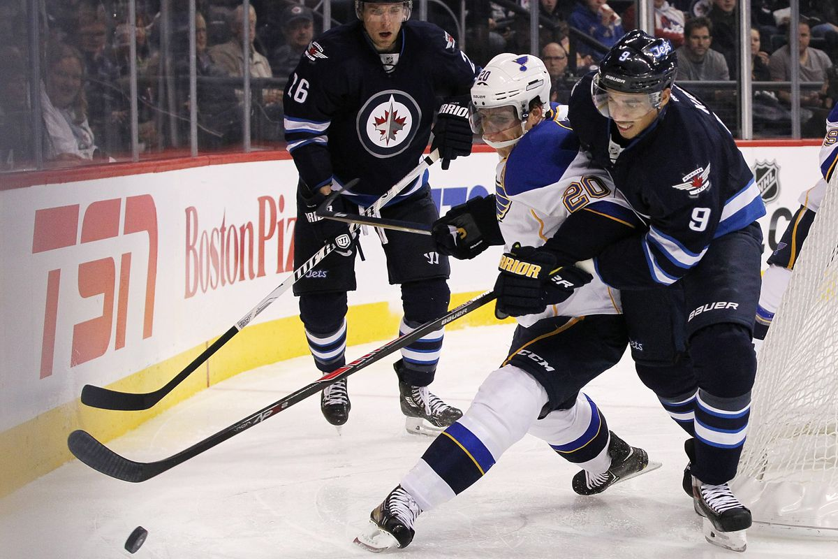 One of the two guys in the foreground is a respected hockey player in Winnipeg. The other is Evander Kane.