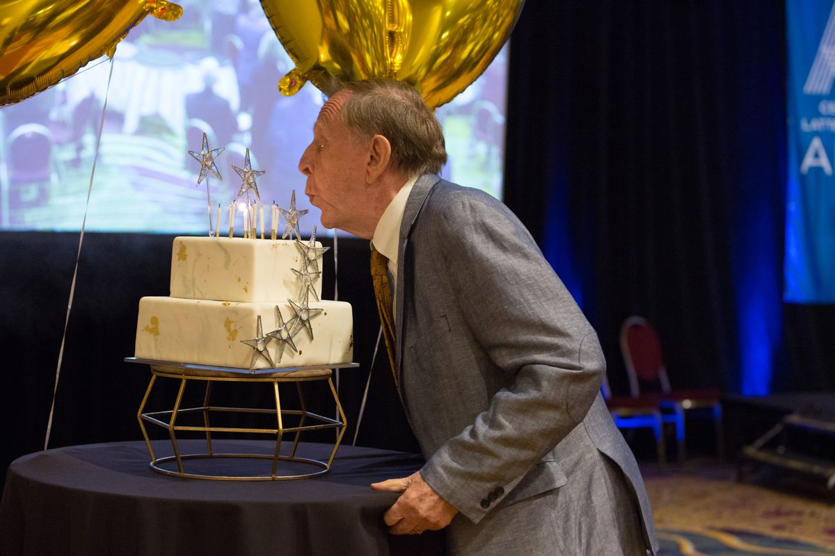 Richard Bushman blows out candles on a birthday cake at a dinner on Saturday, Sept. 25, 2021.