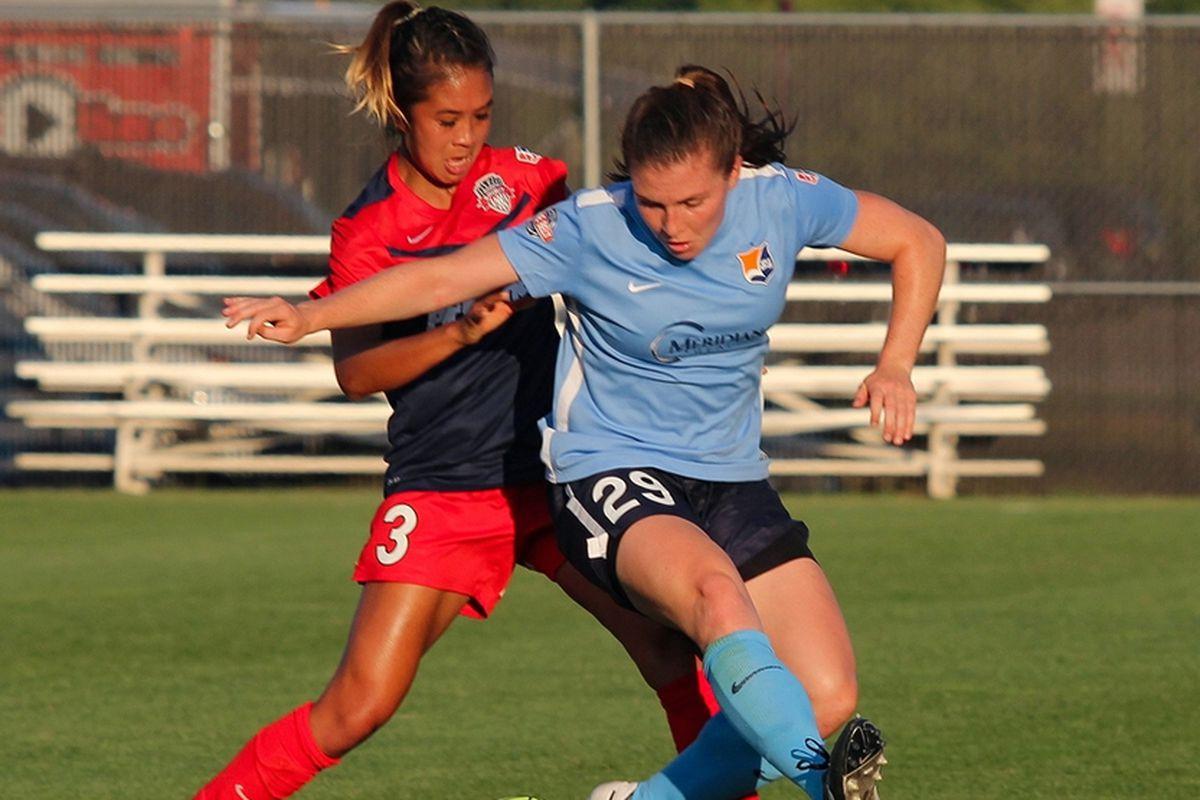 Catherine Zimmerman battles Caprice Dydasco for possession