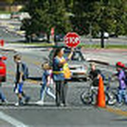 Children leaving school at Edgemont Elementary cross 3650 North along Timpview Drive in Provo. 3650 North is a busy road, but crossing guards help keep kids safe.