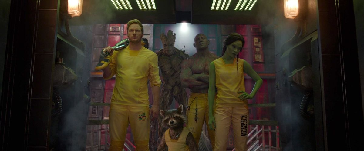 the cast of guardians of the galaxy in yellow prison jump suits