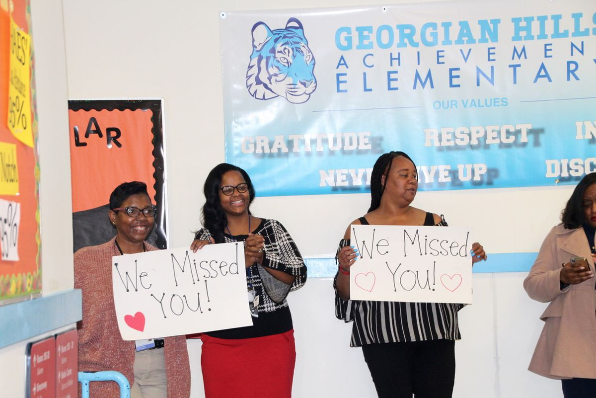 Georgian Hills staff made signs to greet students on Monday.