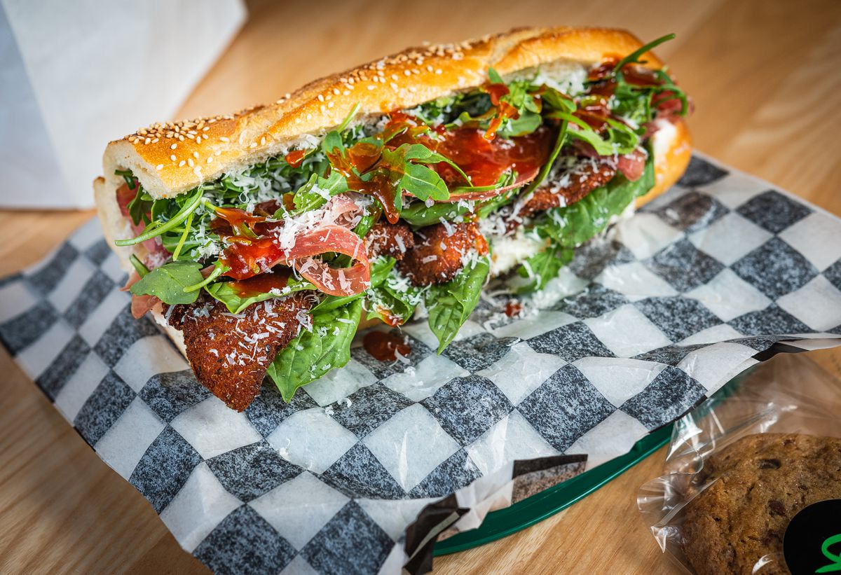 A Rizzo sandwich from Grazie Grazie buries a chicken cutlet in greens, pink prosciutto, and red Calabrian chile-honey
