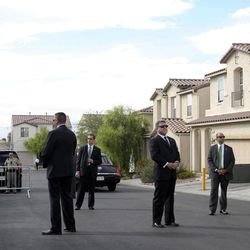 FILE - In this Monday, Oct. 24, 2011 file photo, Secret Service agents stand guard as President Barack Obama meets with the neighbors of homeowners Jose and Lissette Bonilla in Las Vegas. The Secret Service has been tarnished by a prostitution scandal that erupted April 13, 2012 in Colombia involving 12 Secret Service agents, officers and supervisors and 12 more enlisted military personnel ahead of President Barack Obama's visit there for the Summit of the Americas.