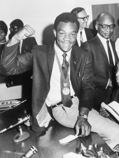 George Foreman Wearing His Gold Medal