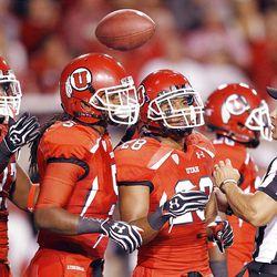 The Utah defense returns the ball to the ref  in Salt Lake City  Sunday, Sept. 16, 2012.