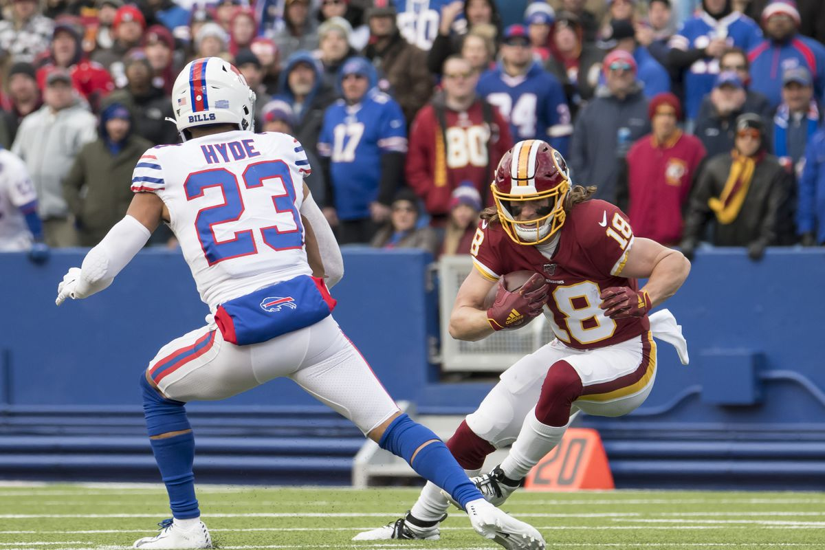 Washington Redskins wide receiver Trey Quinn looks to break a tackle by Buffalo Bills strong safety Micah Hyde in the third quarter at New Era Field.