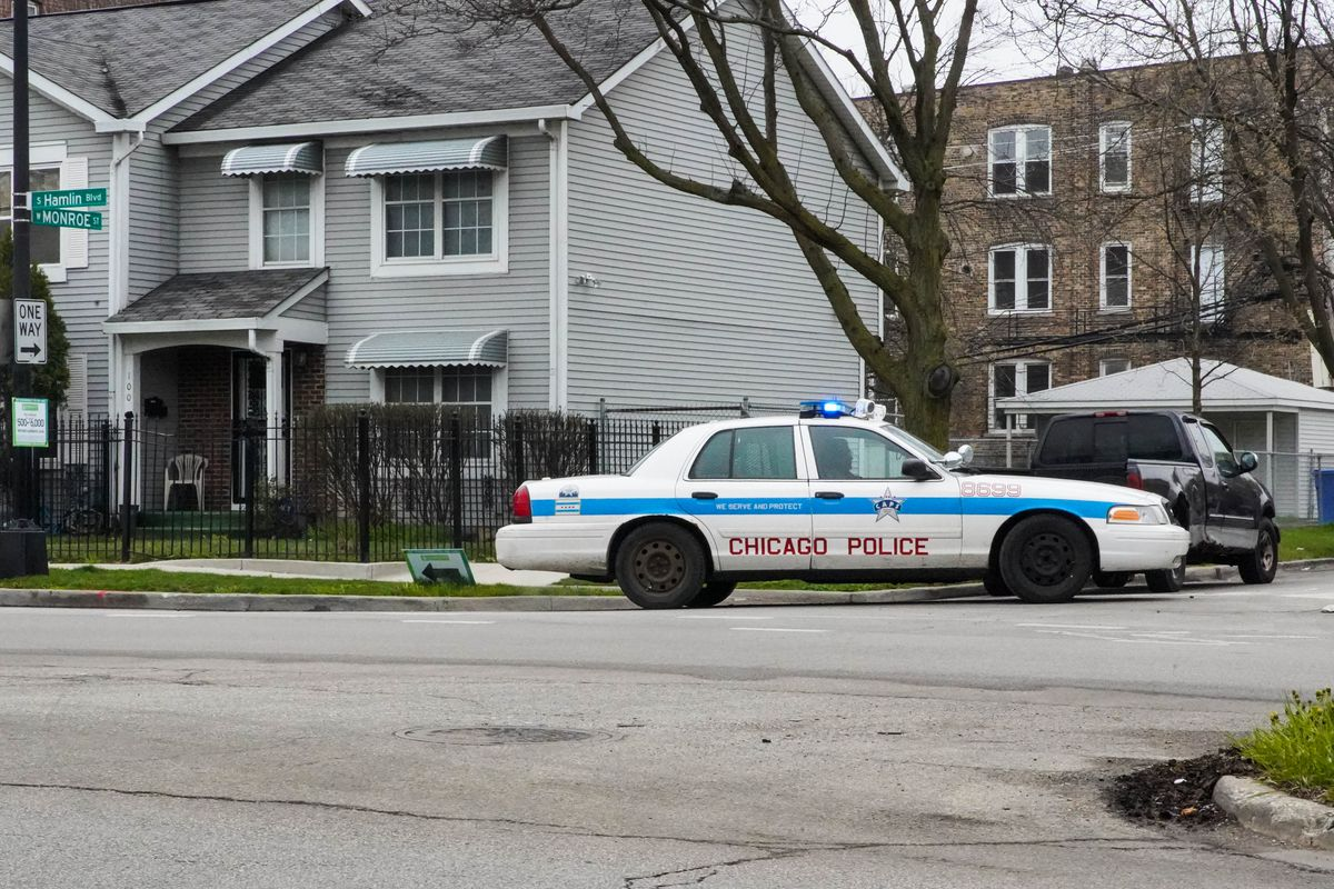 A Chicago Police Department squad car sits on the corner of West Monroe Street and South Hamlin Boulevard on the West Side, Friday morning, April 24, 2020. | Annie Costabile/Sun-Times