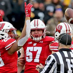Jack Sanborn (#57) celebrates his first half fumble recovery, the first of his UW career.