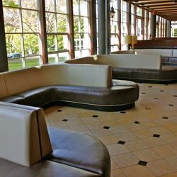 Banquettes fill the area in front of the bar, just to the right of the entrance.
