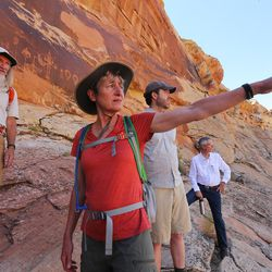 Interior Secretary Sally Jewell asks questions about rock art in Butler Wash near Bluff in southern Utah on Saturday, July 16, 2016.