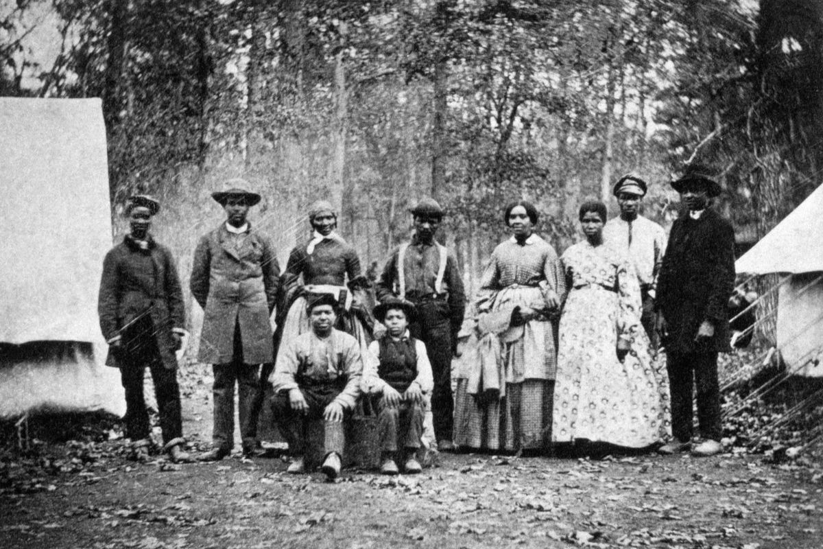 A group of formerly enslaved people who worked as laborers and servants with the 13th Massachusetts Infantry Regiment during the American Civil War, circa 1862