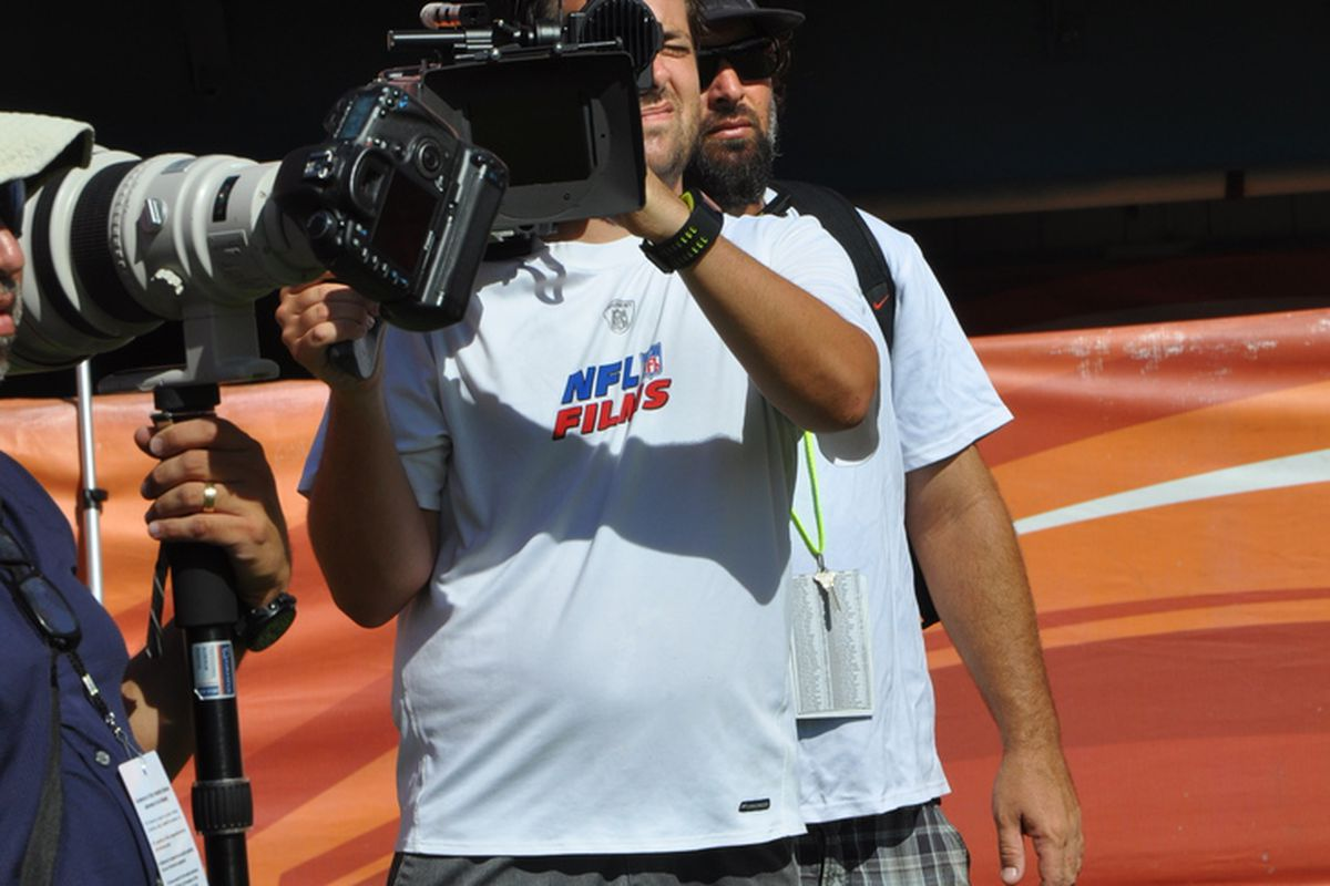 An NFL Films camerman films the Miami Dolphins scrimmage at Sun Life Stadium on August 4, 2012.  The Dolphins will be featured in the NFL Films and HBO production of Hard Knocks this season. (Credit: Austin Schindel - XFINITY Sports)