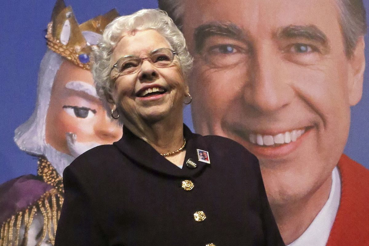 Joanne Rogers stands in front of a giant Mister Rogers Forever Stamp following the first-day-of-issue dedication in Pittsburgh in 2018.