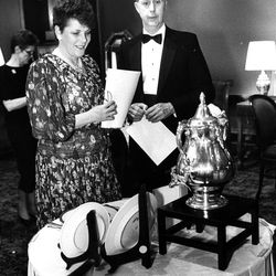 Jack and Janet Cox of Farmington look at a silver plated urn, Wallace Samovar used to serve tea in the Hotel Utah lobby. March 11, 1989.
