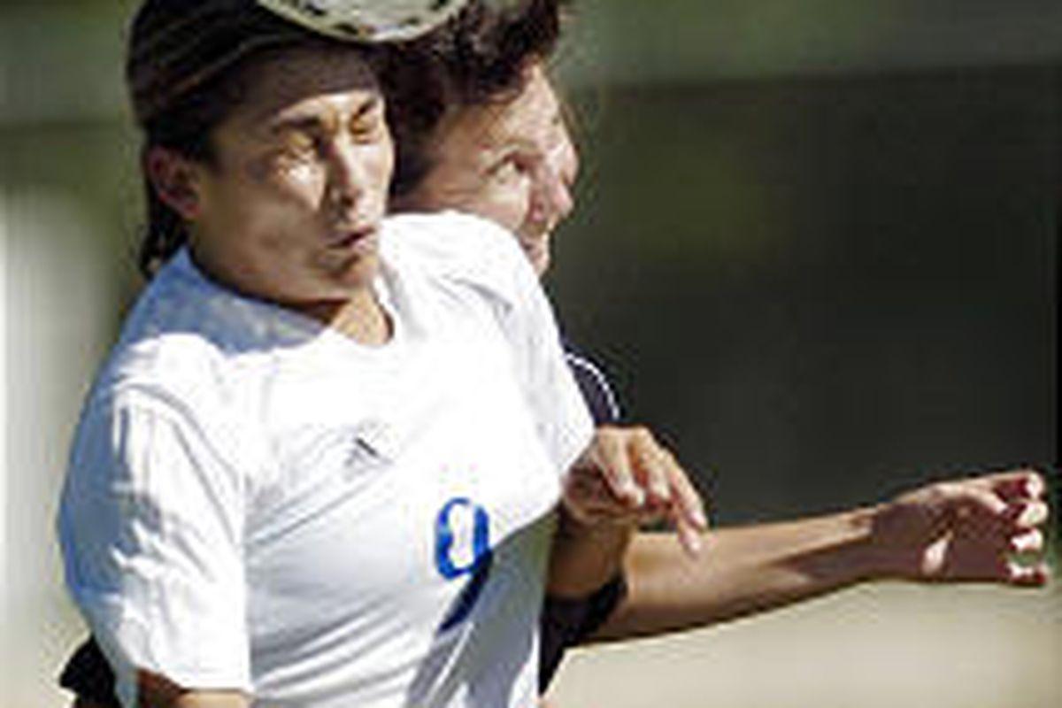 Bingham High School's Natasha Aiono (9) heads the ball with Riverton High's Amber Hunt (5) defending.