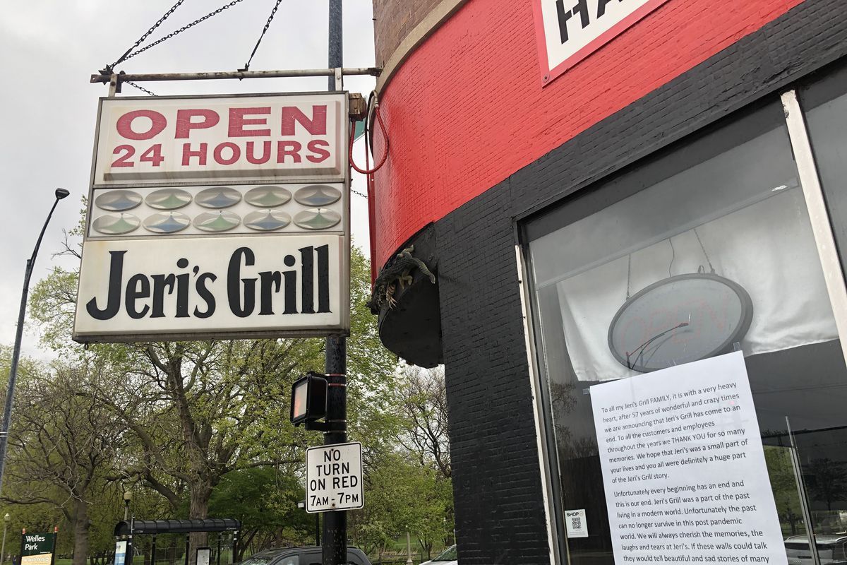 """A sign reading """"Open 24 Hours"""" and """"Jeri's Grill"""" hangs outside a diner."""