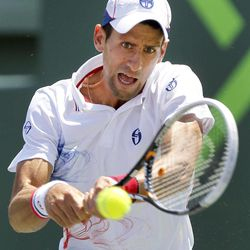 Novak Djokovic, of Serbia, returns a shot from Andy Murray, of Great Britain, during the men's singles final match at the Sony Ericsson Open tennis tournament on Sunday, April 1, 2012, in Key Biscayne, Fla.