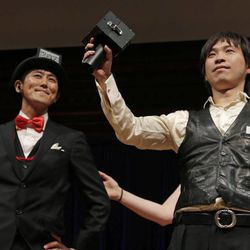 Japanese researchers Kazutaka Kurihara, left, and Koji Tsukada accept their award during a performance at the Ig Nobel Prize ceremony at Harvard University, in Cambridge, Mass., Thursday, Sept. 20, 2012. The Ig Nobel prize is an award handed out by the Annals of Improbable Research magazine for silly sounding scientific discoveries that often have surprisingly practical applications.