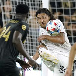 Real Salt Lake defender Marcelo Silva, right, kicks the ball as Los Angeles FC defender Jesus Murillo watches during the first half of a Major League Soccer match Saturday, July 17, 2021, in Los Angeles.