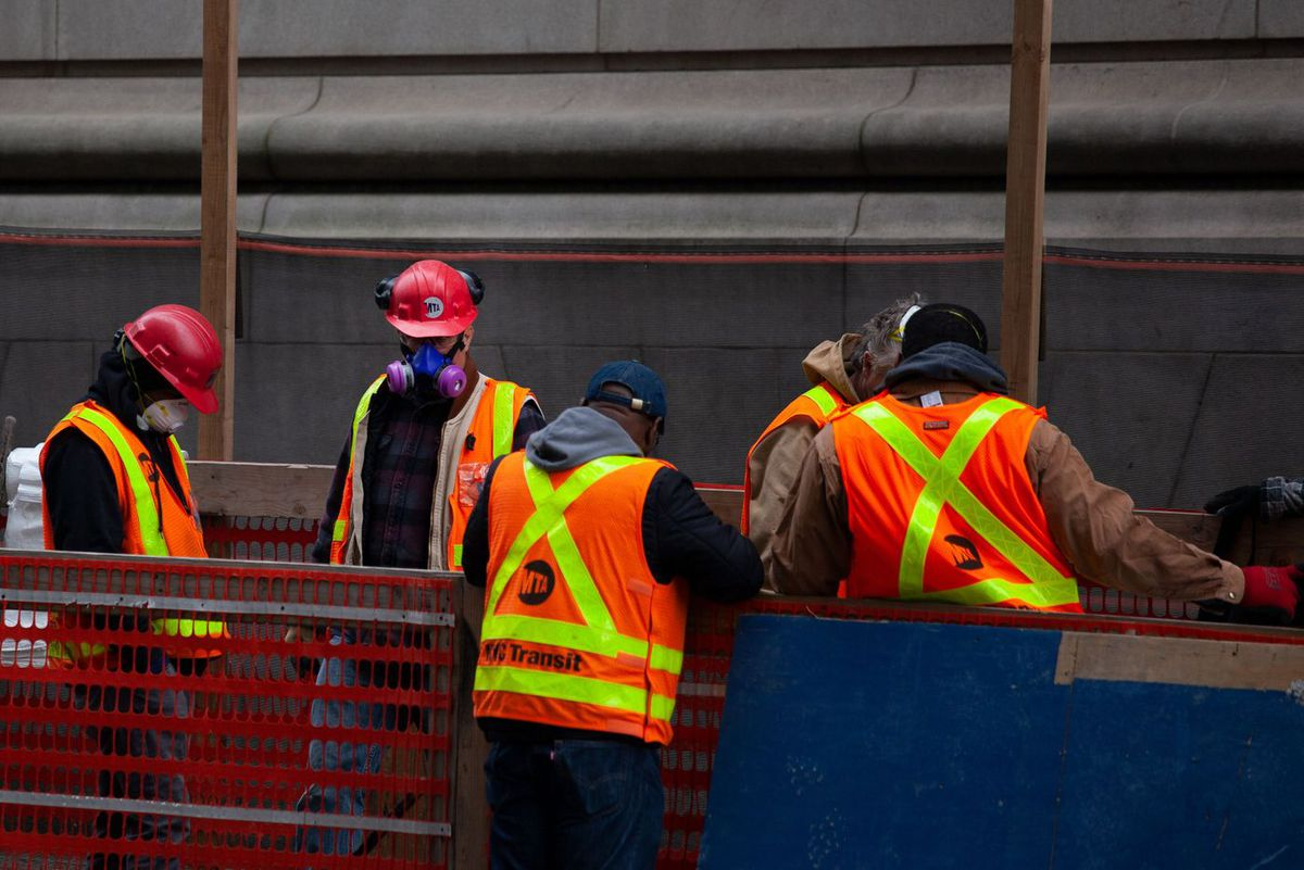 MTA employees work near the City Hall station during the coronavirus epidemic.