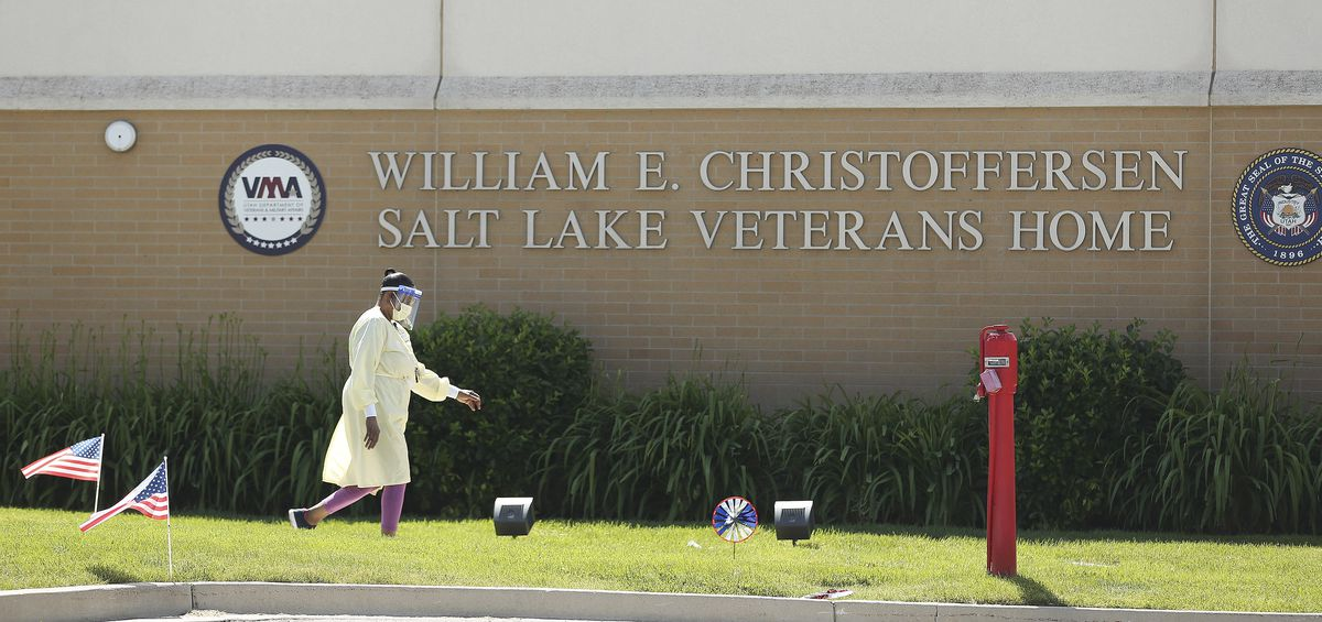 A worker walks in front of the William E. Christoffersen Salt Lake Veterans Home in Salt Lake City on Friday, May 29, 2020. The facility has had a COVID-19 outbreak.