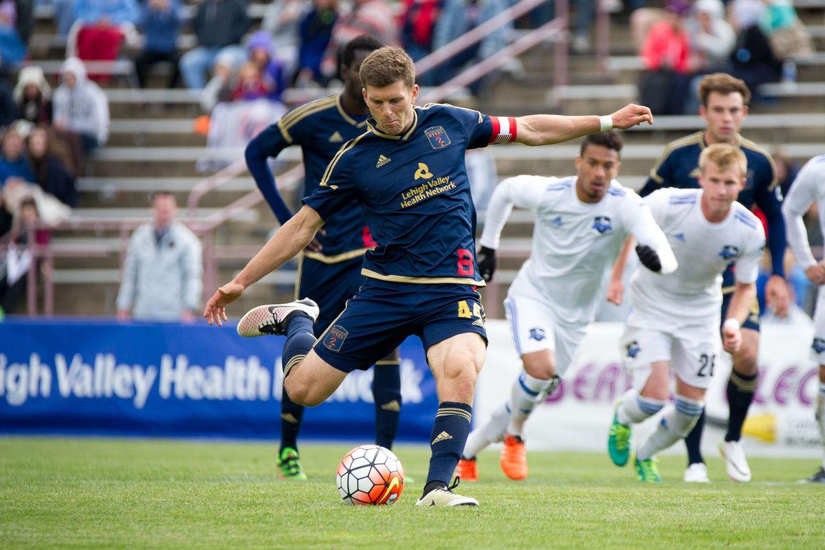 Steel FC captain Ryan Richter bangs home a penalty.