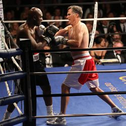 Former Massachusetts Gov. Mitt Romney fights five-time heavyweight champion Evander Holyfield during a charity event for Charity Vision at the Rail Event Center in Salt Lake City on Friday, May 15, 2015.