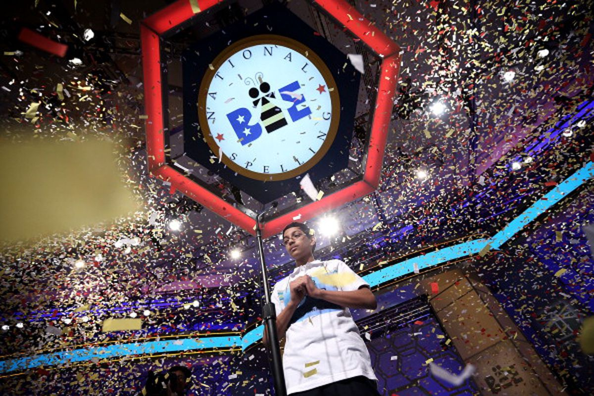 Confetti falls over Arvind Mahankali of Bayside Hills, New York, after the  finals of the 2013 Scripps National Spelling Bee May 30, 2013, ...