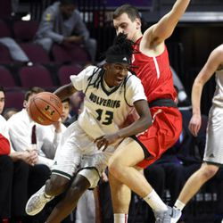 Utah Valley's Ivory Young (13) drives the ball against Seattle's Mattia Da Campo during the first half of an NCAA college basketball game in the first round of the Western Athletic Conference tournament Thursday, March 9, 2017, in Las Vegas. (AP Photo/David Becker)