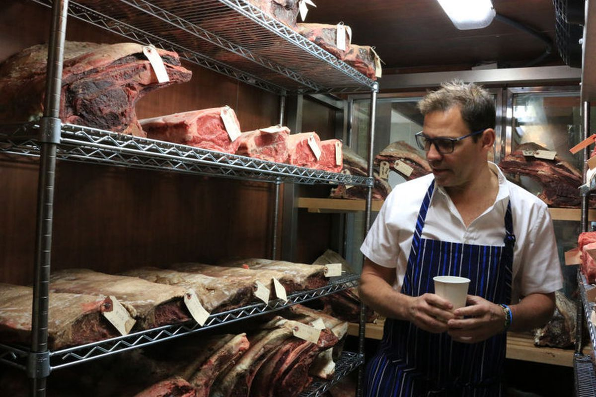 Tesar checks on his meat-aging room at Knife.