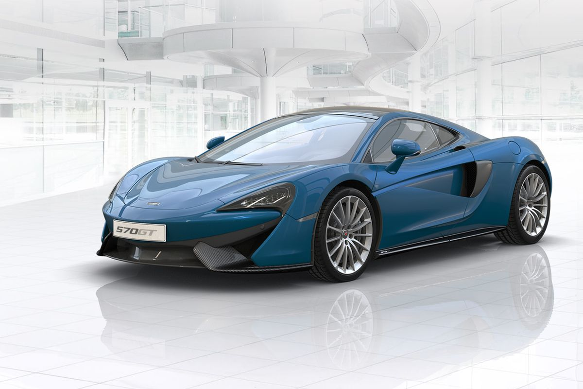 A blue car, so sporty it looks like it's from outer space, against a white background.