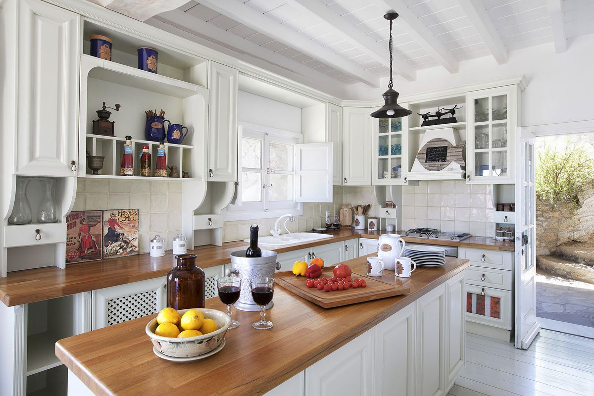 Wood countertop in white kitchen.